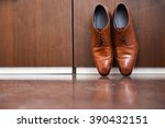 brown leather shoes sitting on... | Shutterstock . vector #390432151
