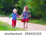 kids playing in autumn park.... | Shutterstock . vector #390432235
