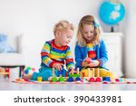 children playing with wooden... | Shutterstock . vector #390433981