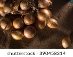 onions background with burlap... | Shutterstock . vector #390458314