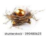 golden egg in nest on white... | Shutterstock . vector #390480625