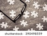 glasses and blank puzzel pieces.... | Shutterstock . vector #390498559