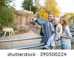 family with child in zoo | Shutterstock . vector #390500224