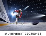 Hockey Players Shoots The Puck...