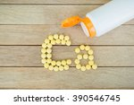 yellow pills forming shape to... | Shutterstock . vector #390546745