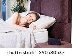 sick woman on bed in bedroom... | Shutterstock . vector #390580567