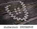 necklace and earrings on a... | Shutterstock . vector #390588949