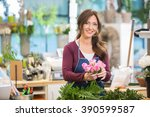 happy florist making bouquet of ... | Shutterstock . vector #390599587