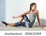 Fitness Woman Stretching Legs...