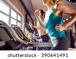 two fit women running on... | Shutterstock . vector #390641491