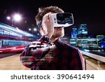 Stock photo double exposure man wearing virtual reality goggles night city 390641494