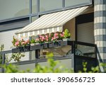 balcony with awning opened and... | Shutterstock . vector #390656725