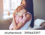 sleepy baby. side view of... | Shutterstock . vector #390663397