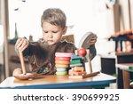 cute little boy interested... | Shutterstock . vector #390699925