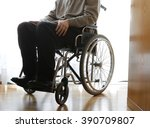 disabled elderly sitting in a... | Shutterstock . vector #390709807