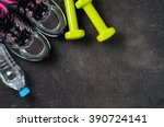 Small photo of Fitness equipment on dark background