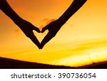 hand shape heart at sunset.  | Shutterstock . vector #390736054
