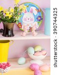 Small photo of Close up of variety easter eggs and bunny plate, bunnies on the shelf.