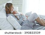 happy mother with newborn baby | Shutterstock . vector #390833539