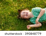 laughing kid lying on green... | Shutterstock . vector #390848779