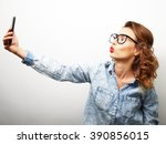pretty hipster girl taking... | Shutterstock . vector #390856015