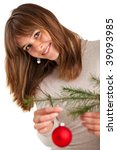 pretty young woman decorating a christmas tree - stock photo