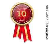 red celebrating 10 years badge  ... | Shutterstock .eps vector #390947509