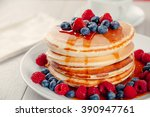 pancakes with berries and maple ... | Shutterstock . vector #390947761