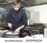 cook decorates a plate of... | Shutterstock . vector #390998509