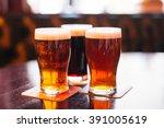 glasses of light and dark beer...   Shutterstock . vector #391005619
