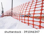 Plastic Fence And Snow  With...