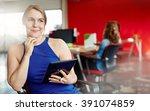 confident female designer... | Shutterstock . vector #391074859