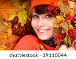 Girl in autumn orange hat on leaf group. Outdoor. - stock photo
