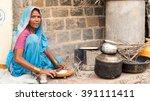 rural women cooking front of...   Shutterstock . vector #391111411