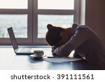 Stock photo tired businesswoman in the office 391111561