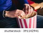 male hand in a bucket of... | Shutterstock . vector #391142941