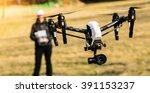 man handling drone in nature | Shutterstock . vector #391153237