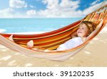 Child Relaxing In A Hammock On...