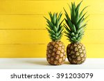 Ripe Pineapples On A White...