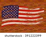 Brick Wall With A Us Flag.