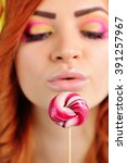 candy lollipop in the hands of... | Shutterstock . vector #391257967