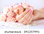 hands of a woman with pink...   Shutterstock . vector #391257991