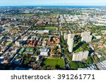 Small photo of Aerial photo of typical Sydney neighbourhood suburb. Residential buildings with office skyscrapers among green parks and sport fields - modern urban infrastructure