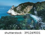 isolated marble beach in greece | Shutterstock . vector #391269031