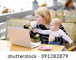 tired young mother working oh... | Shutterstock . vector #391282879