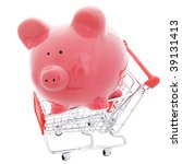 A save money shopping concept with piggy bank in a shopping cart - stock photo