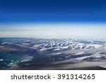 Cumberland Peninsula Mountains, Nunavut, Canada - aerial view from 12000 meters
