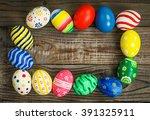 easter eggs on wooden background | Shutterstock . vector #391325911