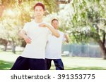 people practicing thai chi in... | Shutterstock . vector #391353775