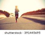 young fitness woman runner... | Shutterstock . vector #391445695